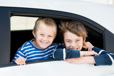 Two smiling boys looking out in the car window Stock Photo - 21195768