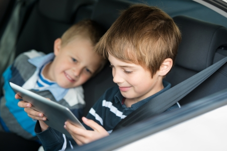 Children playing through touchscreen inside the car photo