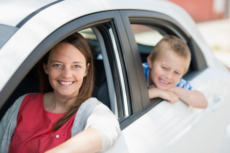 Mother and son waiting for something inside the car photo