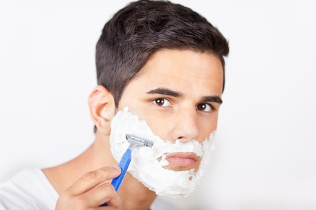 regular people: Portrait of young man shaving Stock Photo