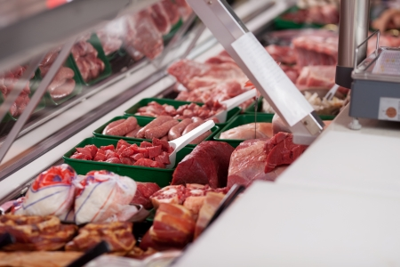 Variety of meat displayed in butchers shop photo