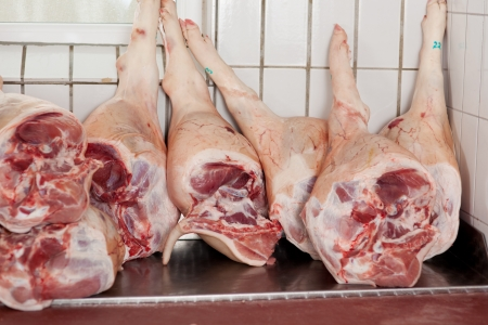 meat counter: Closeup of pork legs displayed in butchers shop