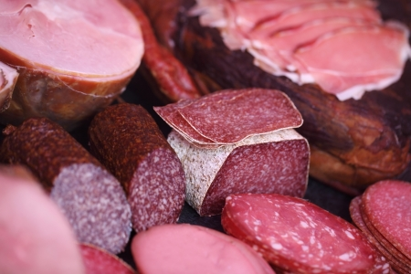 salami: Variety of meat displayed in butchers shop