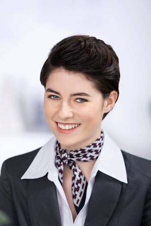 steward: Closeup portrait of smiling confident young businesswoman in hotel