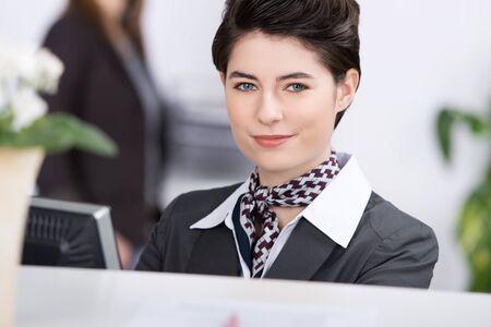 neckcloth: Closeup portrait of confident young receptionist at reception Stock Photo