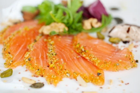 close-up of salmon slices with herbs at restaurant