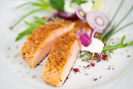 spiced: close-up view of a garnished salmon fillet dish Stock Photo