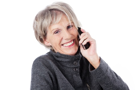 woman phone: Smiling elderly woman with grey hair chatting on the telephone isolated on white