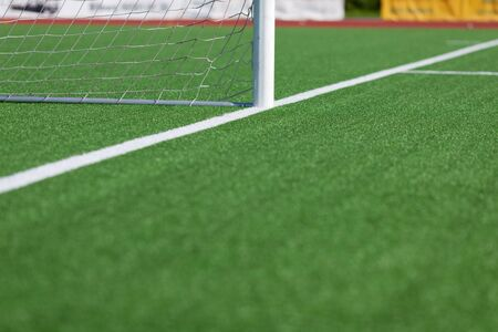 goalpost: Selective focus of soccer field with goal post