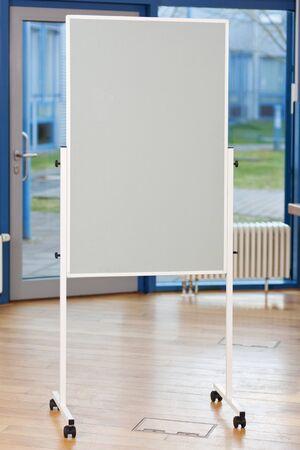 Flip chart on hardwood floor in boardroom photo