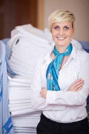 Portrait of young smiling female housekeeper with arms crossed Stock Photo - 21217524