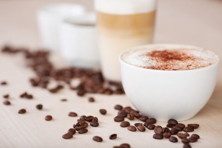 coffees: variety of coffees with coffeebeans in a café