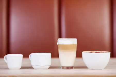 coffees: Variety of coffees displayed on table at cafe Stock Photo