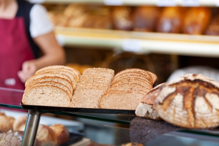 breadloaf: slices of whole meal bread on a counter at bakery