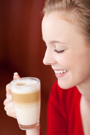 caffee: beautiful woman enjoying caffee latte in a coffee shop