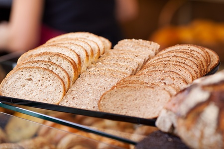salesgirl: slices of bread arranged on counter of a bakery Stock Photo