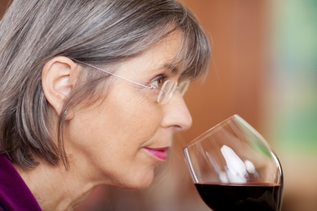 Closeup portrait of woman drinking red wine in restaurant photo