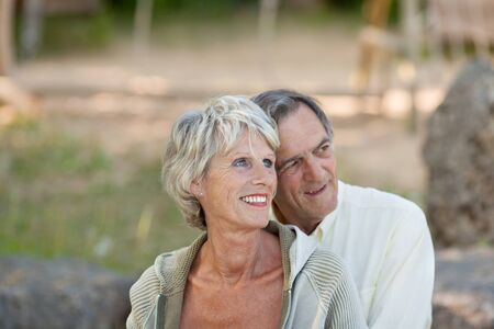 Portrait of mature couple looking over the nature background photo