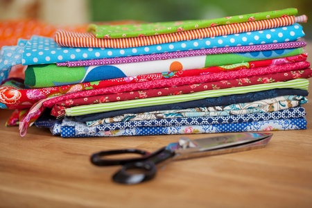 tailor shop: Pile of colorful fabric samples and scissors