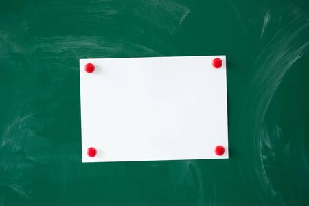 tack board: A piece of paper tacked to a blackboard Stock Photo