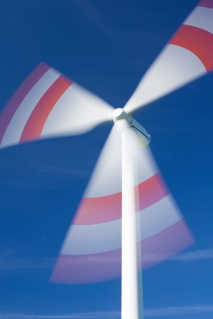windturbine: Low angle view of wind turbine in motion against sky