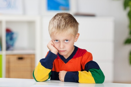angry blonde: Close up portrait of little boy in a bad mood Stock Photo