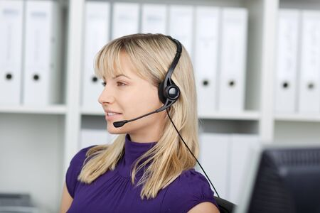 woman using headset, working at customer service photo
