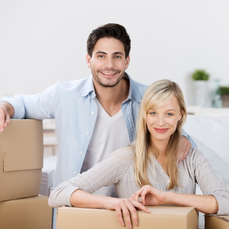 mid adult couple: Portrait of mid adult couple with cardboard boxes at home