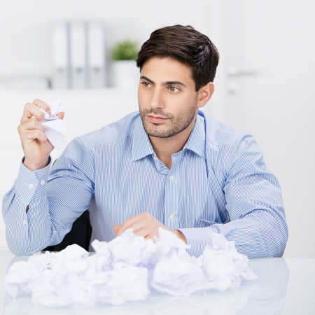 Serious businessman tearing up a document, contract or agreement