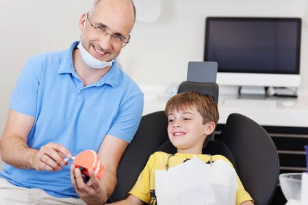 dentalcare: Little boy gets a dentalcare lesson from his dentist