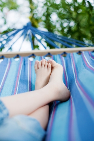 boy: Unrecognized child relaxing in the hammock outdoors