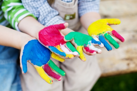 Creative children showing their colorful painted hands Stock Photo