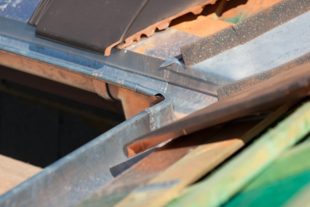 installed: Close-up of a newly installed gutter corner on a rooftop Stock Photo