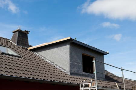 dormer: New dormer and scaffolding structure at the construction site