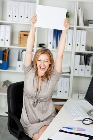 Laughing mid adult businesswoman holding blank paper Stock Photo - 21261030