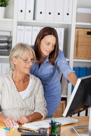 personal assistant: Women from different generations working together in an office.