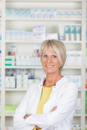 Friendly pharmacist with crossed arms smiling confidently photo