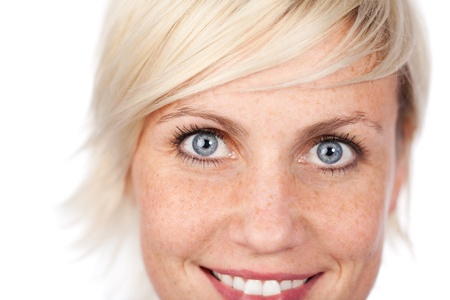 freckles: Closeup of a beautiful blue eyed woman looking at camera against white background