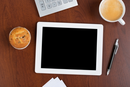 overhead view: Business concept of ipad touch screen, ballpen, cheese cake and coffee