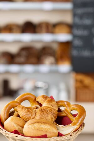 unhealthful: Variety of breads in bread basket on bakery counter