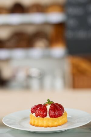 Closeup of strawberry dessert in plate at bakery photo
