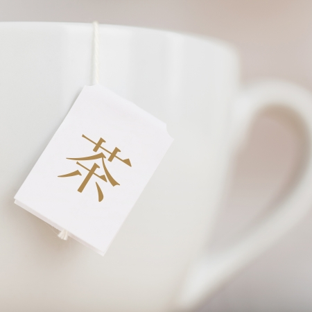 Cropped image of tea cup with Chinese text label