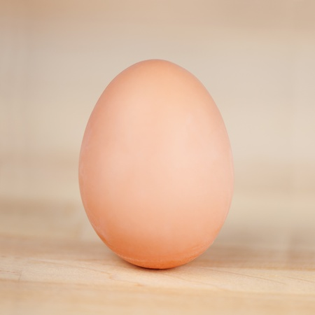 Closeup of an egg on wooden table photo