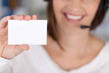 advertising space: Midsection of businesswoman holding blank visiting card