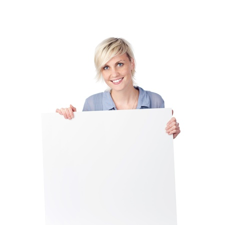 Young blond woman holding white sign against white background photo