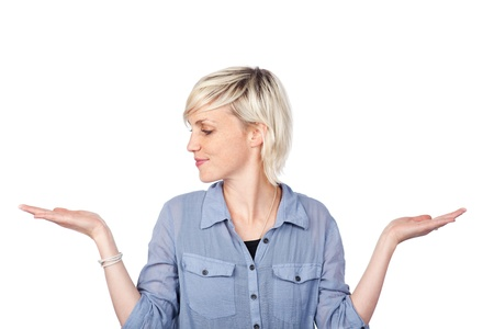 opting: Portrait of a young blond woman holding out her empty palms against white background