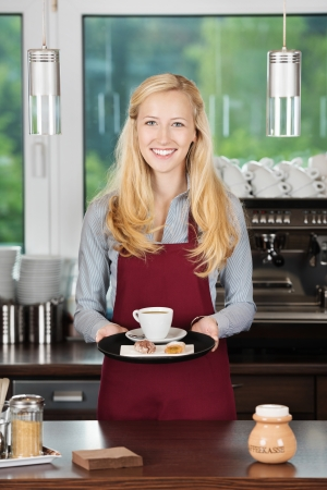 salesgirl: waitress with red apron holding a cup of coffee