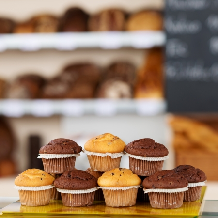 fresh bakery: Stack of muffins arranged on tray at bakery