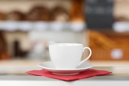 Closeup of coffee cup and saucer on tissue paper photo