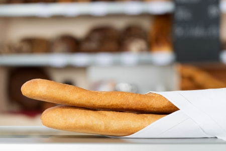 breadloaf: Closeup of baguette breadloaf wrapped in napkin Stock Photo